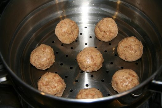 Vegan meatballs in the steamer
