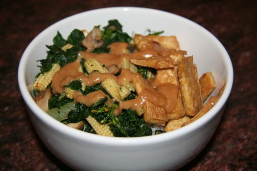 Tofu & greens with Indonesian peanut sauce